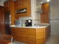 cocina-pvc-madera-encimera-granito